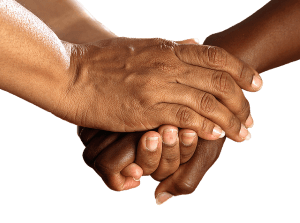 people shaking hands after helping each other